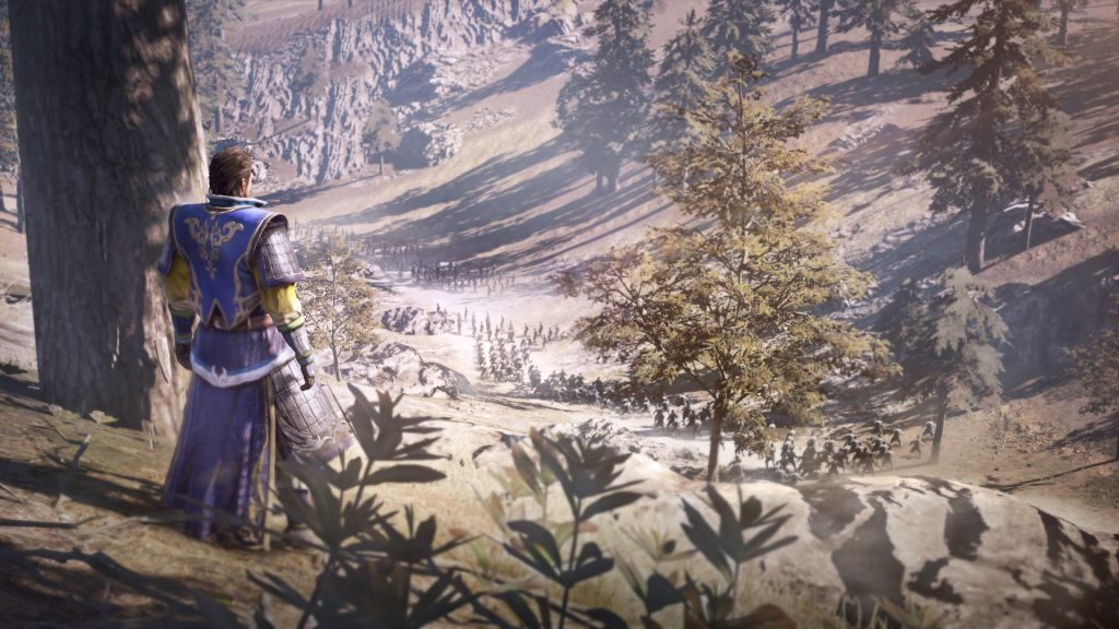 Dynasty Warriors 9 review screenshot: a man looking out over a forest from the top of a hill