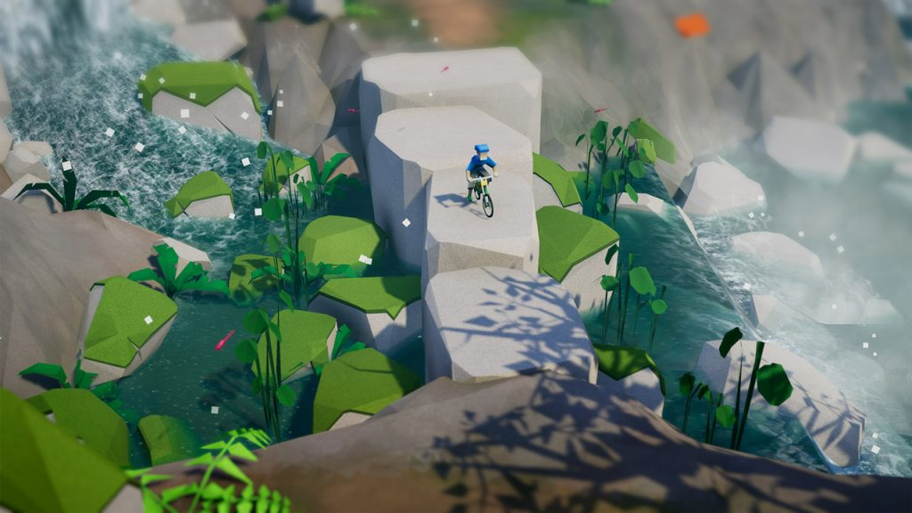 A screenshot from Lonely Mountains: Downhill showing a mountain biker riding across a formation of rocks alongside a waterfall.