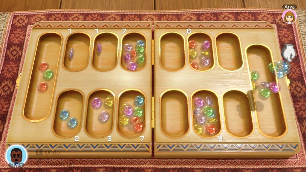 A screenshot from 51 Worldwide Games, showing a game of mancala