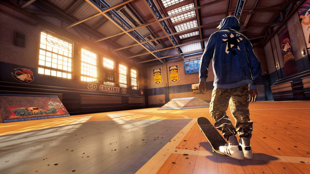 A screenshot from Tony Hawk's Pro Skater 1 + 2 showing a skater from behind, standing with his foot in a skateboard in front of a skate park.